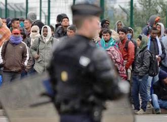 French police carry out an operation to clear a migrant camp