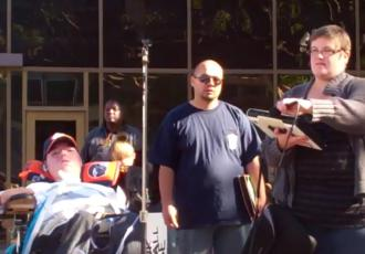Raul Carranza (left) speaks to an Occupy San Diego rally