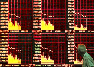 Indicators of China's stock market on a Shanghai street