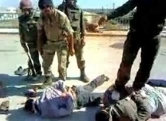 Video footage shows Syrian troops abusing protesters as they lie bound on the street