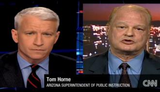 Arizona Superintendent of Public Instruction Tom Horne (right) defends the ban on ethnic studies on CNN's Anderson Cooper 360