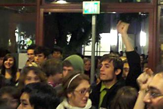 "UC Santa Cruz students push through the library entrance chanting ""Whose university? Our university!"" (Indybay.org)"