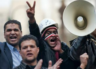 Demonstrators continued a blockade around the parliament building in Cairo (Pedro Ugarte | AFP)