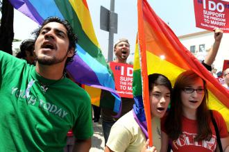 Some 15,000 people turned out in Los Angeles to show their anger with the court decision upholding Prop 8 (Robyn Beck | AFP)