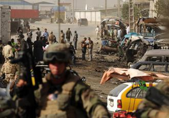 NATO soldiers on the scene of a bomb attack before elections in Afghanistan (Shah Marai | AFP)