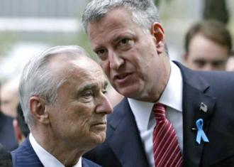 New York City Mayor Bill de Blasio (right) talks to then-Police Commissioner William Bratton