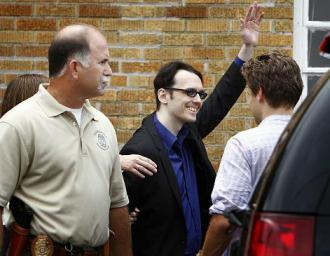 Damien Echols waves to supporters after his release following 18 years on death row