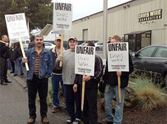 Striking workers picket outside Davis Wire