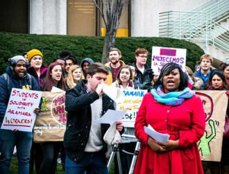 Students rally with Aramark workers at Loyola