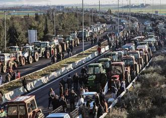 Farmers protesting austerity policies blockade the highway between Athens and Thessaloniki