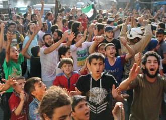 Residents of Aleppo celebrate after rebels broke the regime's siege (Thaer Mohammed)