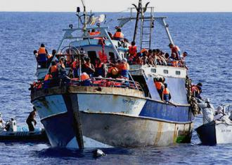 An Italian naval vessel intercepts refugees from sub-Saharan Africa