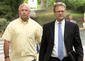 Charles Kleinert (left) arrives at the courthouse to face charges of killing Larry Jackson Jr.
