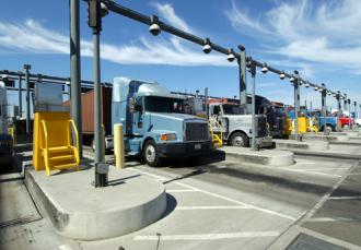 Trucks pass through the gates at the Port of Los Angeles