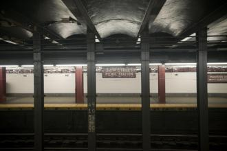 Weekend service cuts leave a New York City subway station empty (Richard B. Levine)