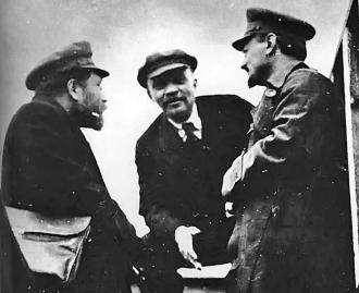 V.I. Lenin (center) and Leon Trotsky (right) in discussions after the Russian Revolution
