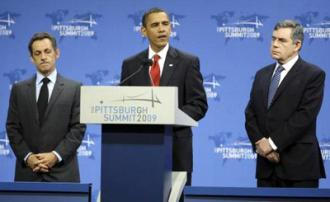 Barack Obama flanked by French President Nicolas Sarkozy (left) and British Prime Minister Gordon Brown