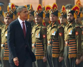 President Obama inspects guards at India's Presidential Palace during a ceremonial welcome