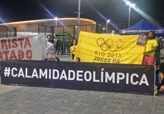 Activists from Rio's Vila Autódromo hold their banners outside the Olympic Stadium   (Zach Zill)
