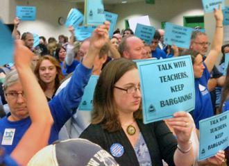 Portland teachers protest outside a session of the school board