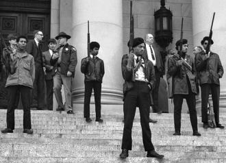 Black Panthers protest outside California's Capitol building against a gun control law aimed at them
