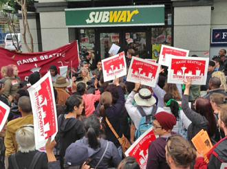 Striking workers and their supporters in Seattle took the streets in front of fast-food restaurants  (Dan Trocolli | SW)