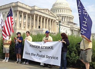 Postal workers held a hunger strike in front of Congress in July
