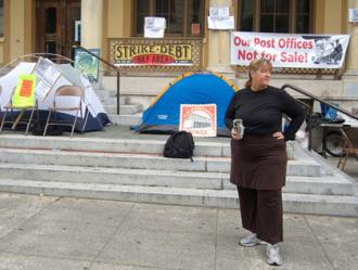 Protesters encamped on the steps of the Berekely post office
