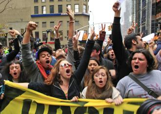 Occupy protesters march toward Liberty Plaza after police evicted them in the early morning hours (Eduardo Munoz | Reuters)