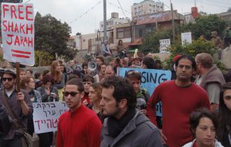 Protesters stand in the back yard of a house now occupied by Israeli settlers in the Sheikh Jarrah neighborhood
