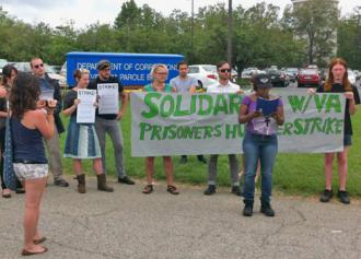 Solidarity activists hold a press conference outside a Department of Corrections office in Virginia
