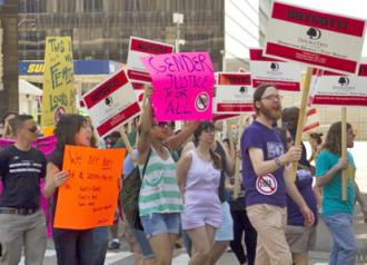 """Protesters gathered in Detroit to condemn a """"Men's Rights"""" conference (Steve Neavling)"""