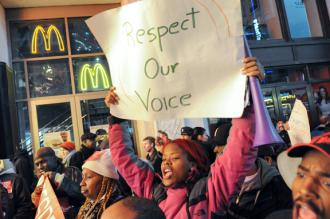 McDonalds workers rally with supporters outside a restaurant near Times Square