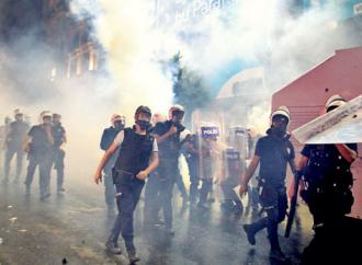 Turkish riot police march through a cloud of tear gas (Jenna Pope | Occupy Gezi)