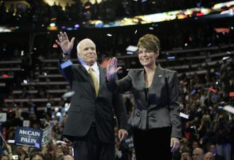 Running mate Sarah Palin joins John McCain onstage at the Republican convention (Brian Kersey   UPI)