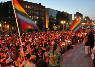 Hundreds of people gathered in Lincoln, Neb., for a candlelight vigil for a hate crime victim (Ricardo Hernandez)
