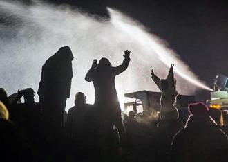 Police at Standing Rock target activists with water cannons in below-freezing temperatures (Adam Alexander Johannson)
