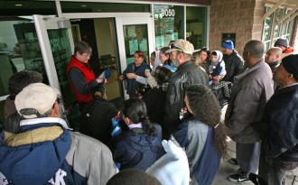 Waiting for help outside a Salvation Army food bank (Zuma)