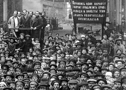 Workers attend a mass meeting in a Petrograd factory