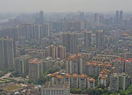 Smog covers the skyline of a working class district in Guangzhou, China (llee_wu | flickr)