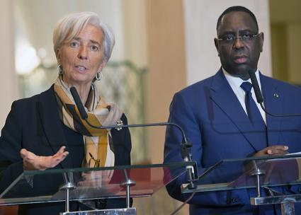 Christine Lagarde of the International Monetary Fund (left) speaks alongside Senegalese President Macky Sall (Stephen Jaffe | flickr)