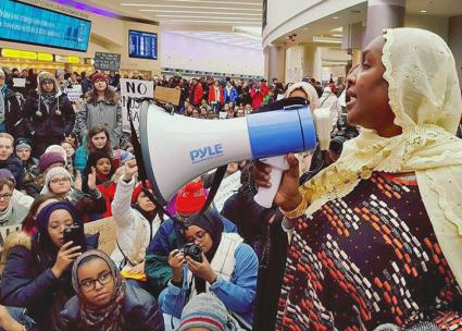 Speaking out against Trump's anti-Muslim ban in the Columbus International Airport (Ohio Interfaith Immigrant and Migrant Justice Coalition)