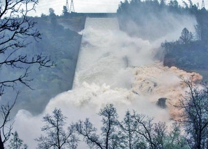 Water from the Oroville Dam in Northern California rages down a spillway