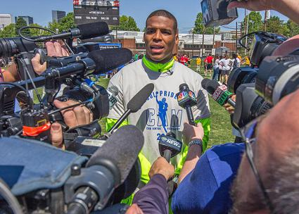 Carolina Panthers quarterback Cam Newson speaks to reporters (Grant Baldwin | flickr)