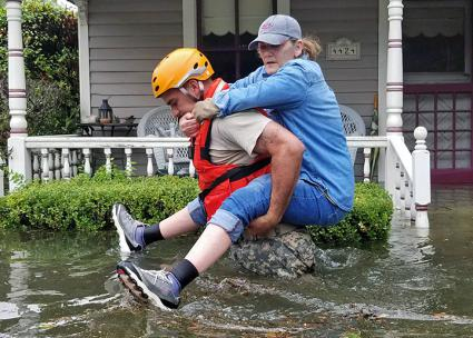 A Houston resident is rescued in the aftermath of Hurricane Harvey (Lt. Zachary West)