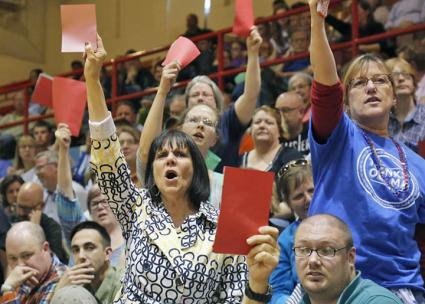 Hundreds pack a town hall meeting in Iowa to protest a Tea Party member of Congress