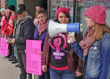 Pro-choice activists mobilize to protect one of the three remaining abortion clinics in Wisconsin (Madison NOW | Facebook)