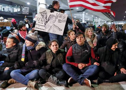 Opponents of Trump's ban at an airport sit-down