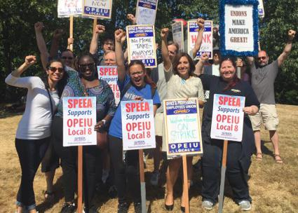 Striking pension workers and their allies on the picket line in Seattle (OPEIU Local 8 | Facebook)