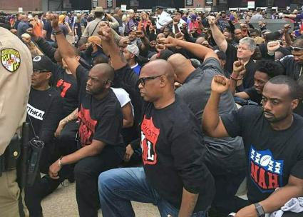 Anti-racist activists take a knee in solidarity outside the Baltimore Ravens stadium (Colin Kaepernick Fans Family | Facebook)